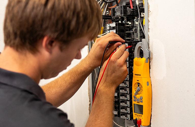 Electrician Working on Breaker