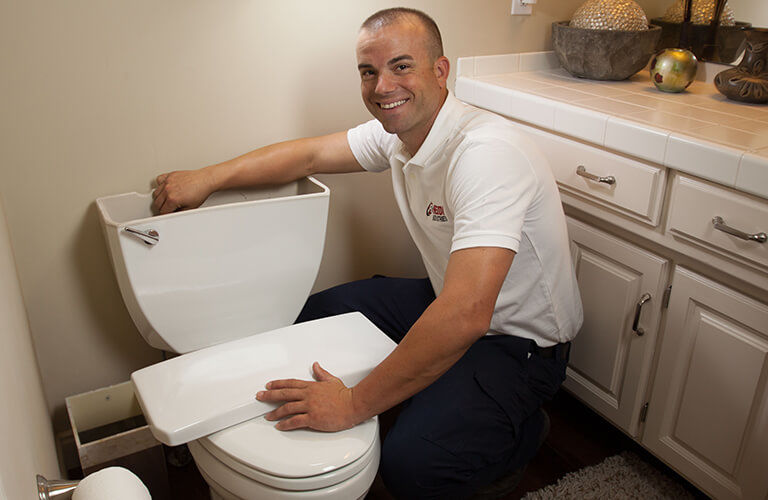 Reddi Plumber Repairing Toilet